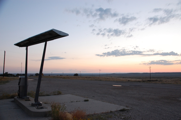 Driving from Denver to Jackson - abandoned gas station sunrise